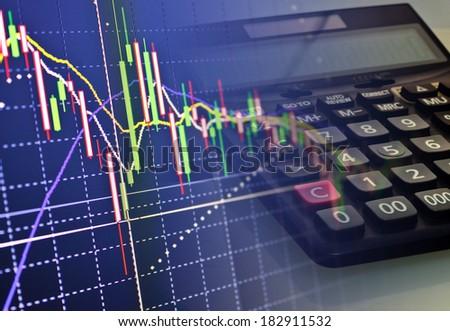 Finance graph and calculator keyboard - stock photo