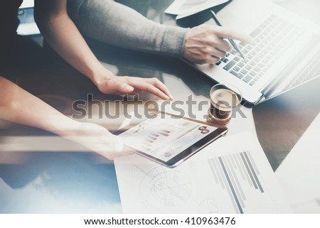 Finance investment work process.Photo woman showing business report modern tablet,diagram screen.Banker man holding pen for signs document,discussion startup idea.Horizontal.Film and bokeh effect