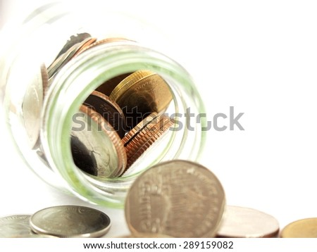 Finance, money saving, collected coins in glass, Thai baht money, isolated on white background - stock photo