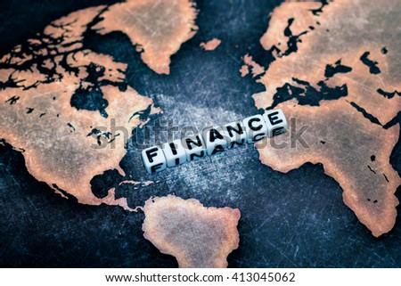 FINANCE on grunge world map - stock photo