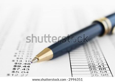 Finance report paper with ballpoint pen. Very shallow depth of field. - stock photo