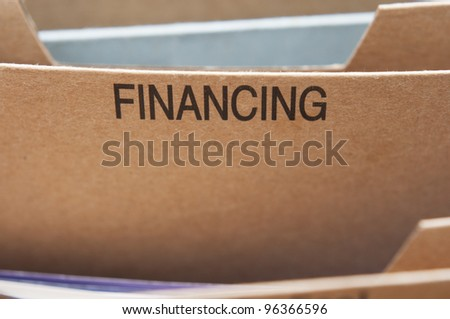 Finances section tab in folding file. - stock photo