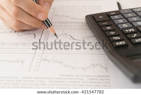 Financial Ad visor stock market graphs analysis. Investment, Analysis, Financial Services Concept. - stock photo