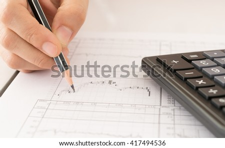 Financial Adviser stock market graphs analysis. Investment, Analysis, Financial Services Concept. - stock photo