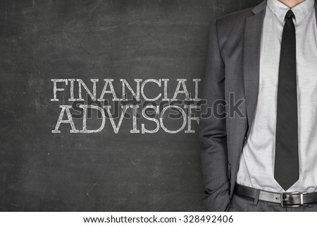 Financial advisor on blackboard with businessman in a suit on side - stock photo