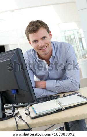 Financial advisor receiving customer in his office - stock photo