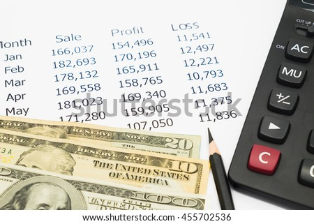 Financial  analyzing investment with calculator, financial or accounting concepts - stock photo