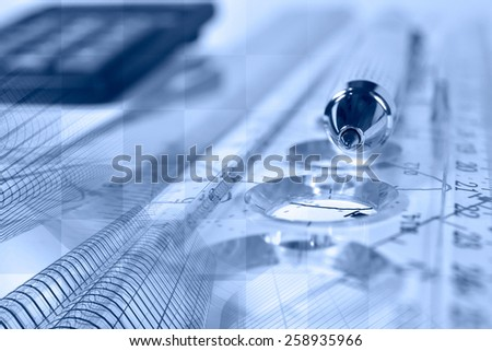 Financial background in blues with buildings, calculator, graph and pen. - stock photo