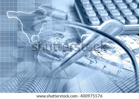 Financial background in blues with map, calculator, graph, glasses and pen. - stock photo