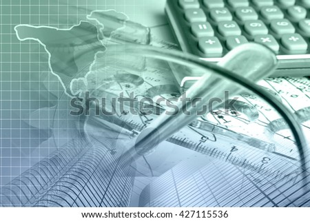 Financial background in greens and blues with graph, calculator, map and pen. - stock photo