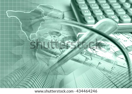 Financial background in greens with graph, calculator, map and pen. - stock photo