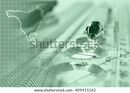 Financial background in greens with map, buildings, ruler, graph and pen. - stock photo