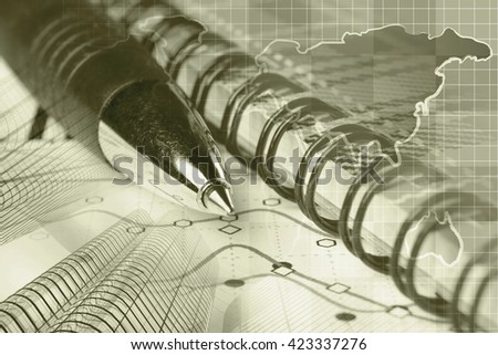 Financial background in sepia with buildings, map, graph and pen. - stock photo