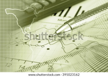 Financial background in sepia with map, calculator, graph and pen. - stock photo