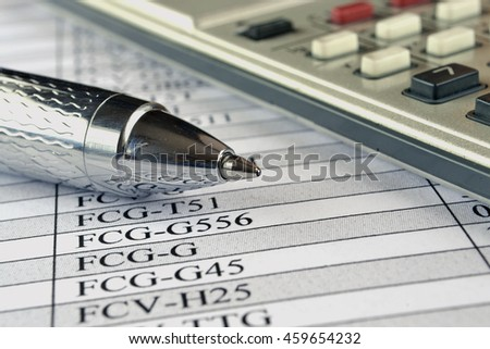Financial background with calculator, table and pen. - stock photo
