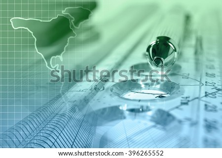 Financial background with graph, ruler, map and pen, in greens and blues. - stock photo
