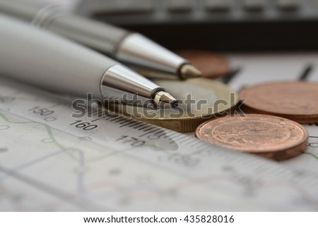 Financial background with money, calculator, ruler, graph and pens. - stock photo