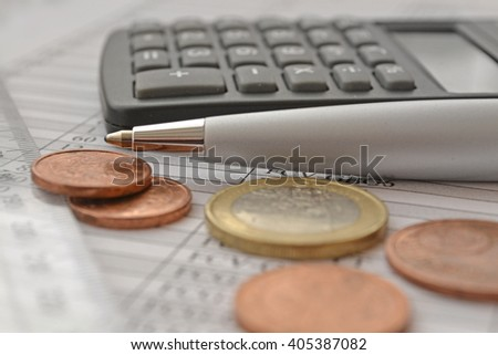 Financial background with money, calculator, ruler, table and pen. - stock photo