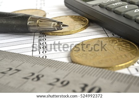 Financial background with money, calculator, ruler, table and pen.