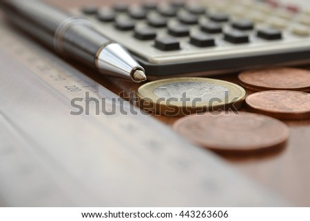 Financial background with money, calculator, table and pen. - stock photo