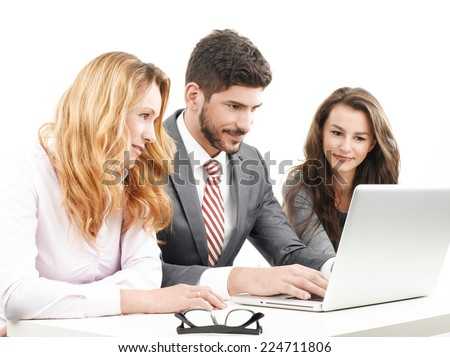 Financial business people working on laptop and analyzing data, while sitting against white background. - stock photo
