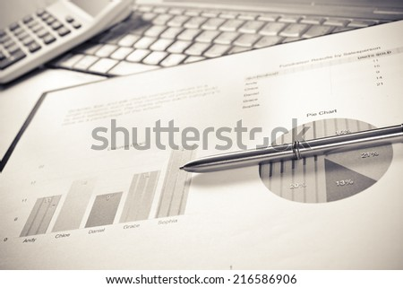 financial charts and graphs on the table,Office working area - stock photo