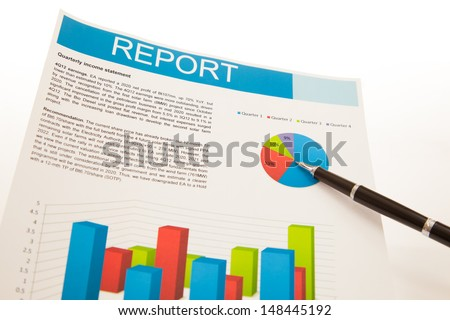 Financial charts and graphs with pen - stock photo