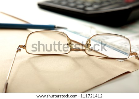 Financial charts with pen - stock photo
