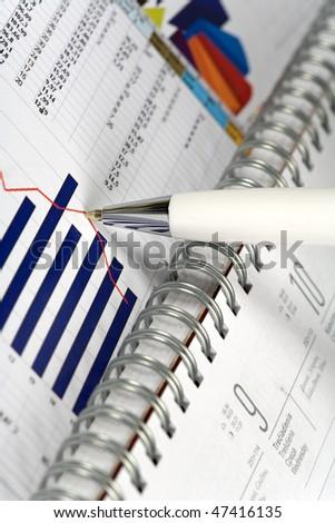 Financial concept. Calculator and pen. - stock photo