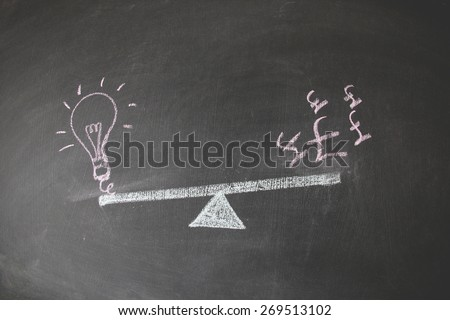 Financial concept designed with colored chalk on blackboard. This photo may use as financial background. Illustration is showing the balance between currency and idea and concept.