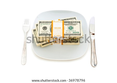 Financial concept - eating money isolated on white
