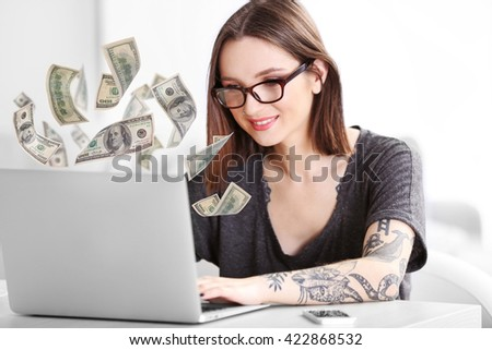 Financial concept. Make money on the Internet. Young woman working with laptop - stock photo