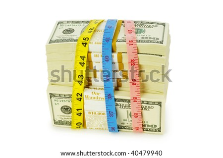 Financial concept - measuring money isolated on white - stock photo