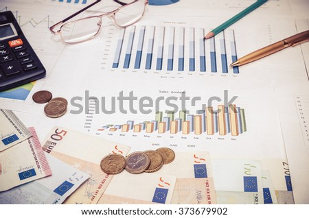 Financial concept with euro bills, calculator, graph and pen. toned image - stock photo