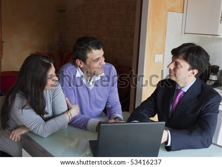 Financial Consultant with Adult Couple - stock photo