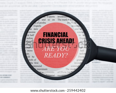 Financial crisis ahead under magnifying glass - stock photo