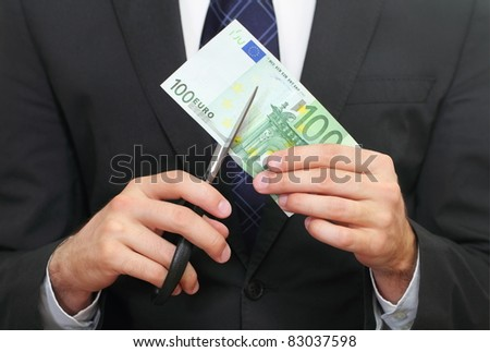 Financial crisis. Business concept with euro and scissors - stock photo
