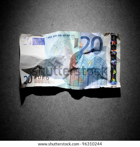 Financial crisis concept - crumpled 20 euro banknote on gray background - stock photo