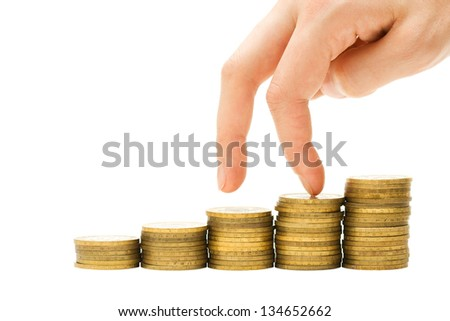 Financial crisis concept - hand going down staircase of coins