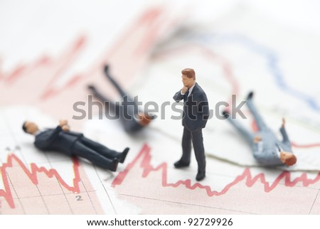 Financial crisis. Figures of businessman on financial charts - stock photo