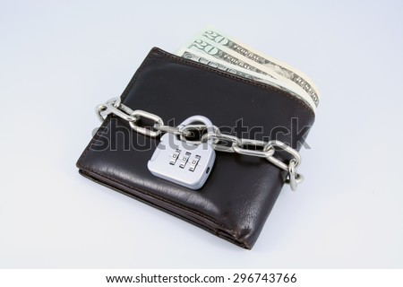 Financial crisis. Old brown leather wallet with lock on it.