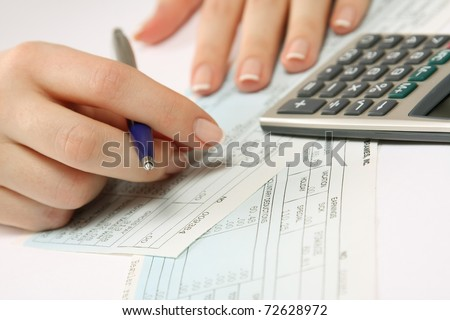 Financial data analyzing. Counting on calculator - stock photo