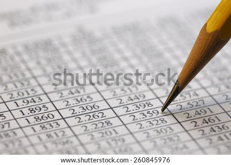 Financial data analyzing , shot with very shallow depth of field - stock photo