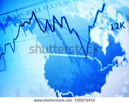 Financial diagram and abstract digital map of USA on a monitor - stock photo