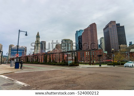 Financial District and Custom House Tower at North End Park at Cross Street in downtown Boston, Massachusetts, the US. People on the background