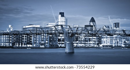 Financial District and Millennium Bridge, London. This view includes :Tower 42 Gherkin,Willis Building, and Stock Exchange Tower and Millennium Bridge. - stock photo