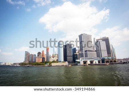 financial district of manhattan in new york city seen from the ferry to staten island during a sunny day