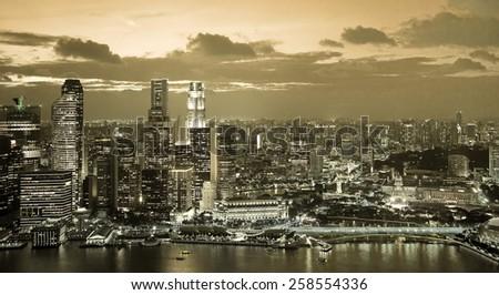 financial district of Singapore illuminated at twilight - stock photo