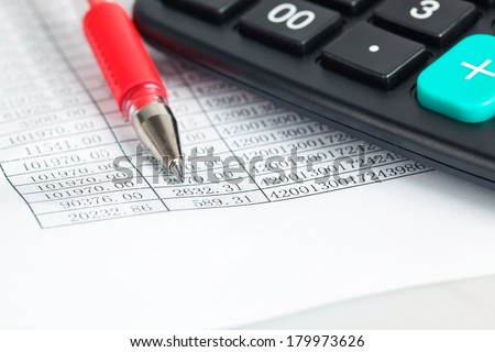 financial documents closeup with calculator and red pen - stock photo