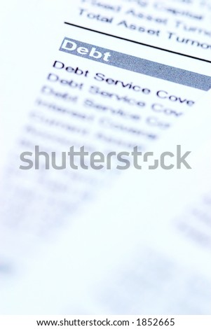 "Financial documents with focus on the word ""debt"" - stock photo"